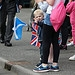 A little boy welcomes the Glasgow 2014 Queen's ...