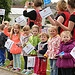 Children line the streets as the Glasgow 2014 Q...