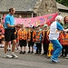Children cheer and hold a banner as Batonbearer...