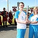 Batonbearer 007 Liam Brannan hands the Glasgow ...