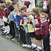 School children line the streets as the Glasgow...