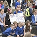 Schoolchildren cheer as the Glasgow 2014 Queen'...