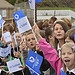 School children waves flags as the Glasgow 2014...