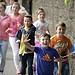 Young spectators cheer on the Glasgow 2014 Quee...