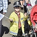 A little boy in a police costume welcomes the G...